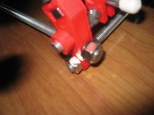 A 3D printed nut is used in a Hacklab Prusa.