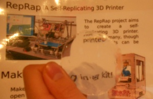 Chris Olah's 3D printer produced lens mangifies text on a poster