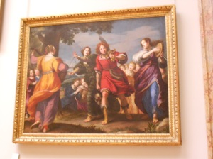 Painting of several women, once has a sword
